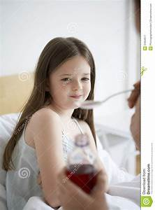 Mother Giving Cough Syrup To Daughter Royalty Free Stock ...