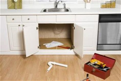 leak kitchen sink cabinet how to protect a cabinet a sink home guides sf gate 8929