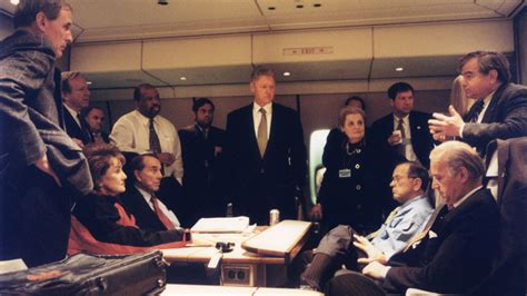 file bill clinton and officials on air force one jpg