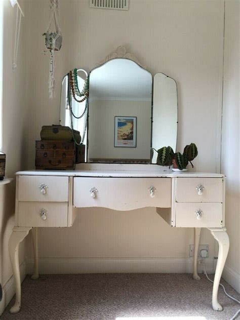 white vintage dressing table with drawers and mirror