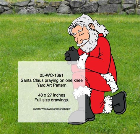 santa claus praying  bended knee woodchuckcanuckcom
