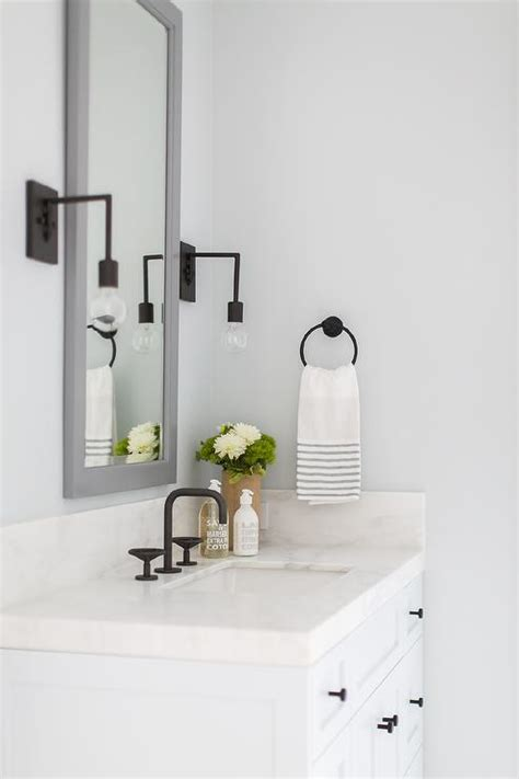 tall gray mirror  white sink vanity transitional