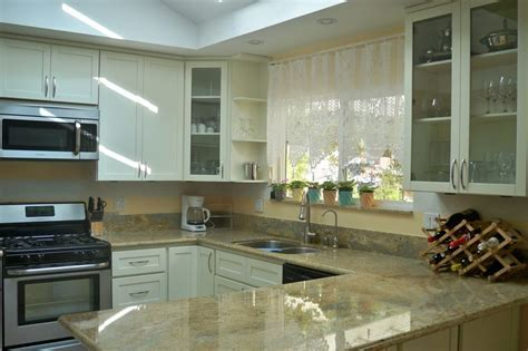Kitchen Cabinets and Granite designed and installed by Nu
