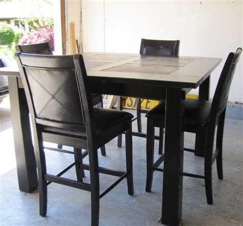 black distressed table and chairs casual outdoor dinette design with espresso pub style