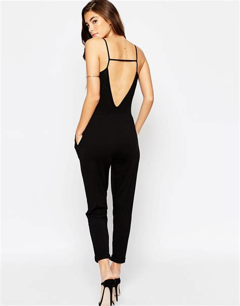 asos black jumpsuit asos plunge jumpsuit with strappy back in black lyst