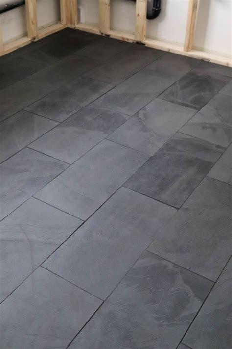 black tile   laundry room black bathroom floor