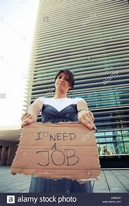 unemployed woman showing a message in a cardboard that she ...