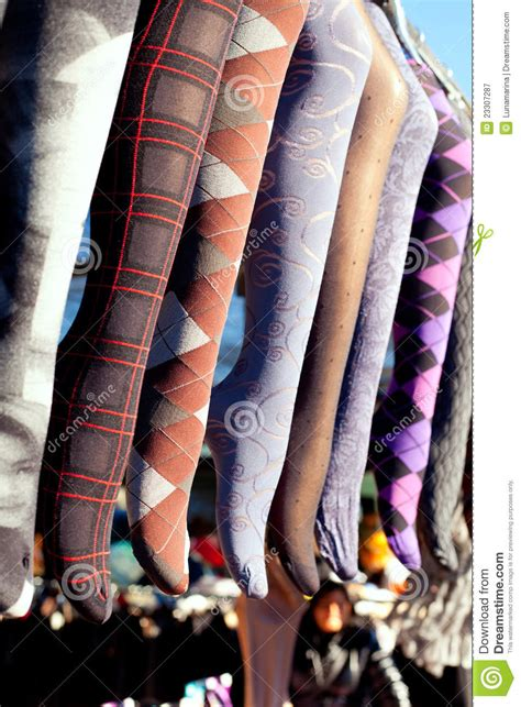 colorful tights   row hanging  market stock image