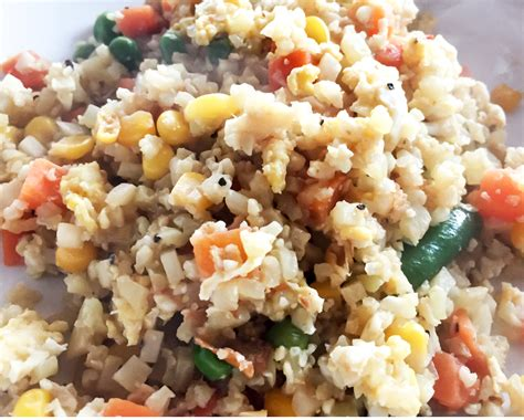 """Rice is stuffed into hearty burritos all the time, so it only makes sense to lighten things up and bring riced cauliflower to a nourishing wrap. Cauliflower Fried """"Rice"""" • Laugh Eat Learn"""