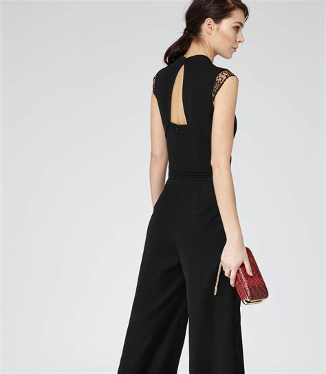 reiss jumpsuit reiss orson lace panelled jumpsuit in black lyst
