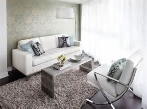 contemporary condo living room with white leather sofa