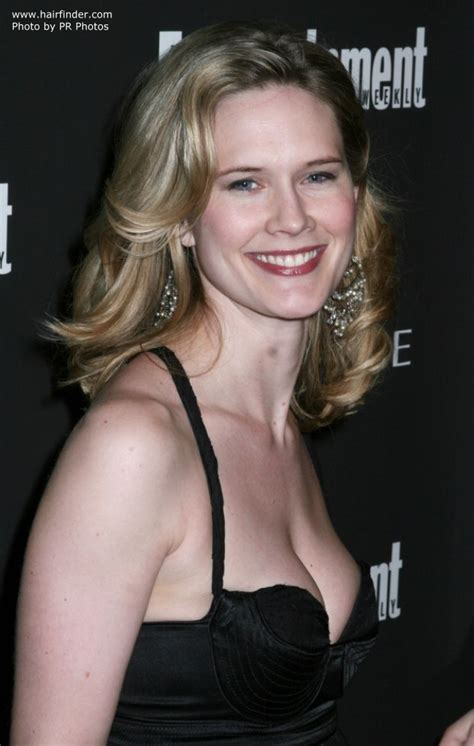 Stephanie March wearing a long hairstyle with random curls