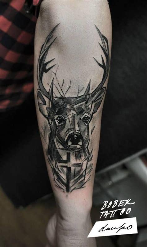 black ink abstract deer head tattoo   arm tats