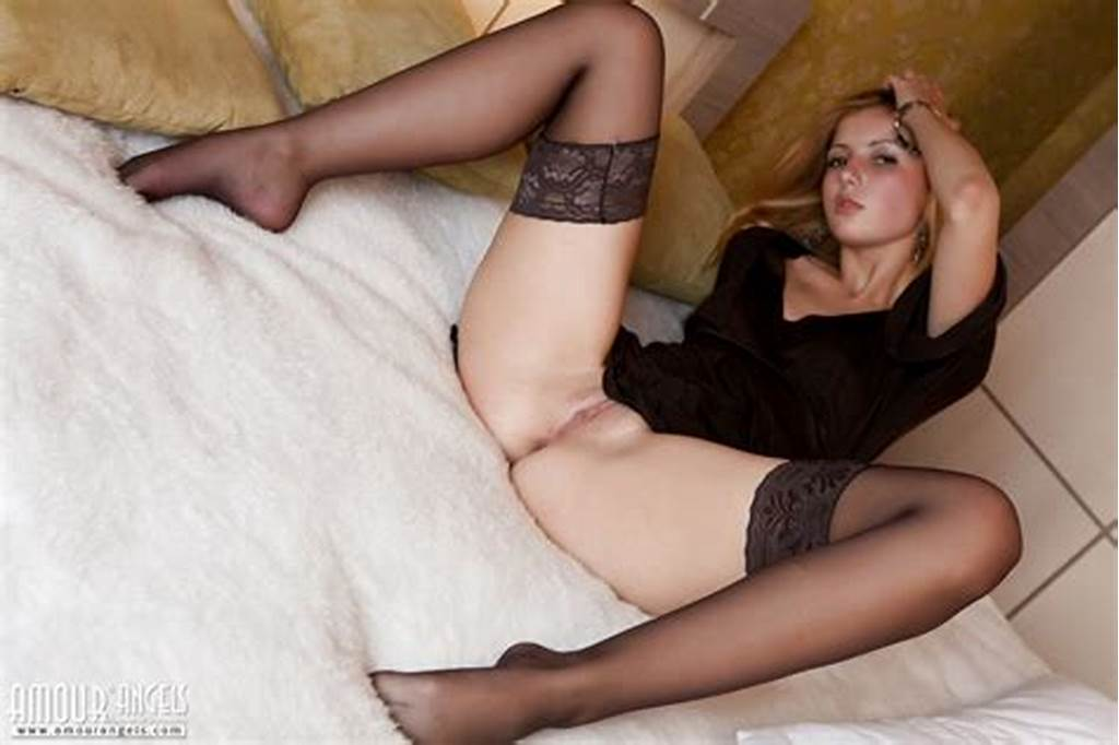 #Beautiful #Teen #Cutie #In #Sexy #Black #Stockings #Showing #Her #Tasty #Shaved #Pussy #And #Ass #On #Bed.