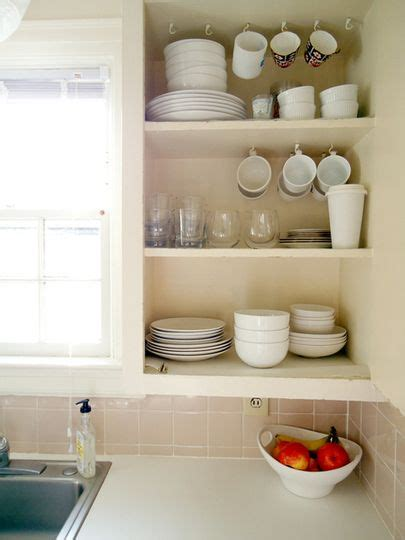 kitchen space savers cabinets space saver in the kitchen hanging mugs live simply 6110
