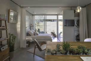The Tiny House Bedroom by White Studios Modern Micro Apartments In Downtown