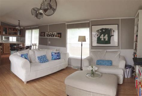 single wide manufactured mobile home remodel makeover living room great room open concept smoked