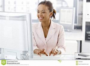 Happy Office Worker Girl At Desk Stock Image - Image: 19263581