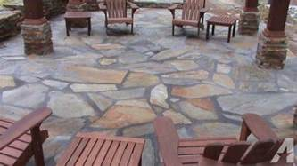 river rock and tennessee flagstone on pallets for sale