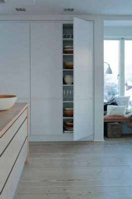 Floor To Ceiling Cupboards by Storage The Colored Wall In The Back Of The