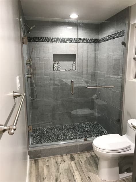Sliced Black Pebble Tile Shower Pan and Border   Tilehub