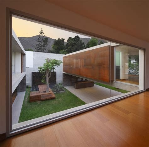 House With Courtyard by Opulent Mansion Connected To The Envinronment Through