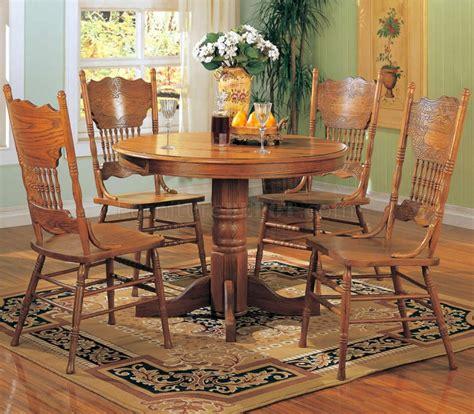 oak finish traditional pc  dining set wpedestal base