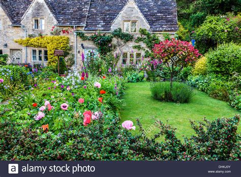 A Pretty English Cottage Garden In The Cotswold Village Of