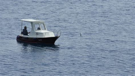 Small Fishing Boat Images by Small Fishing Boat Floating On The Water Stock Footage