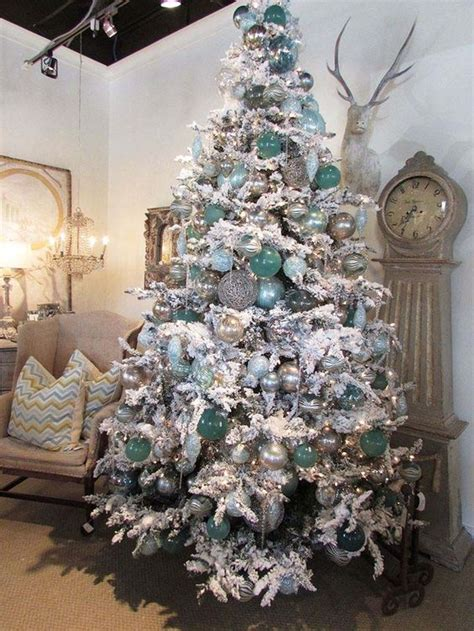 flocked christmas tree decorating ideas 33 chic white christmas tree decor ideas digsdigs