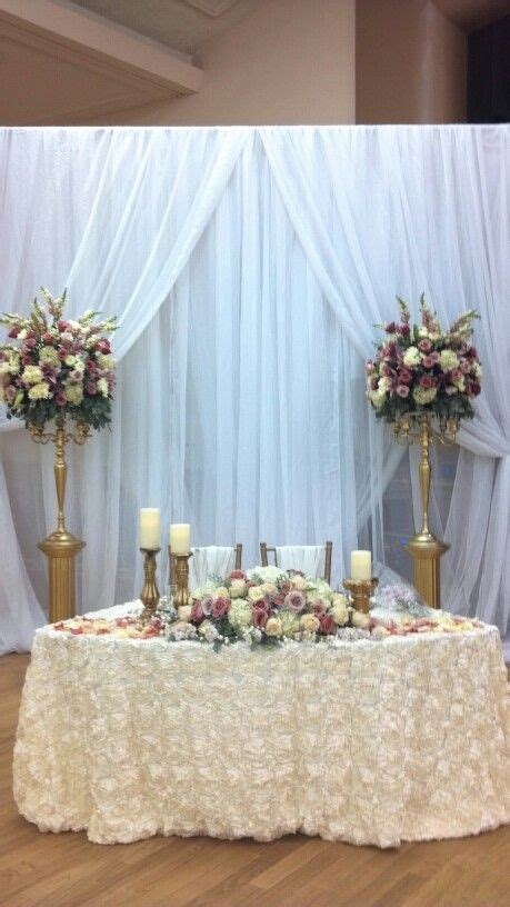 bride and groom table gold rose and ivory wedding in