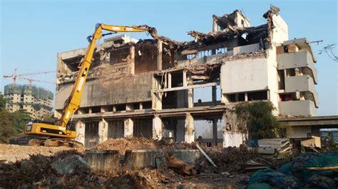 high reach excavator building demolition