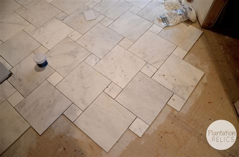how to tile bathroom floor carrara marble master bath flip house update