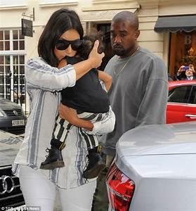 Sleeping beauty! Kim Kardashian cradles a napping North as ...