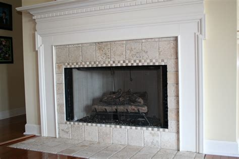 tumbled marble tile on the fireplace surround refresh restyle