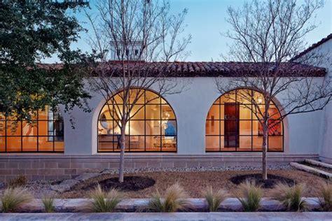 white spanish revival home   row  steel windows hgtv