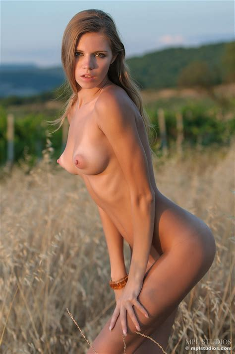 Sexy Blonde Poses Naked In A Field Showing Her Perky Tits With Big Nipples
