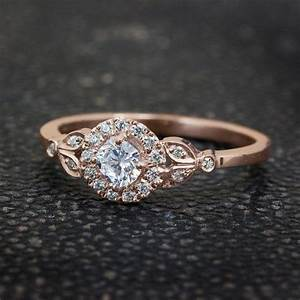 what is an engagement ring supposed to look like With how much is a wedding ring supposed to cost