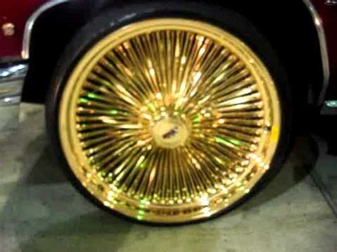 candy apple red caillac    gold daytons rims