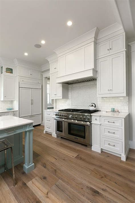 white kitchen cabinets  sawn oak wood floors transitional kitchen