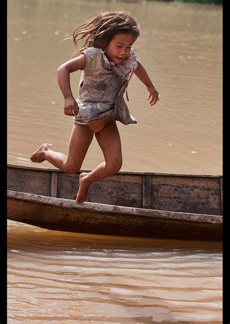 Lanten Girl Jumping Into The Nam Ha River Luang Nam Tha Laos Davestamboulis Ethnic