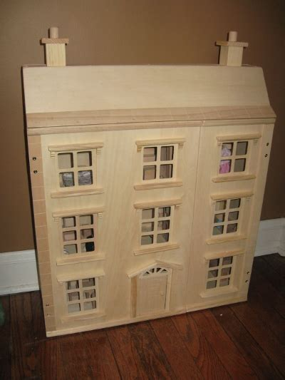imaginarium natural wooden dollhousethat  bought