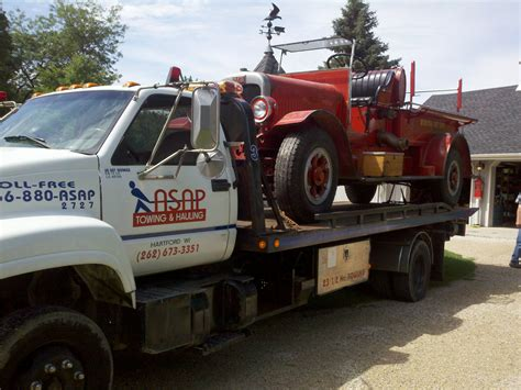 Towing And Hauling by Asap Towing Hauling Inc Hartford Wisconsin Wi