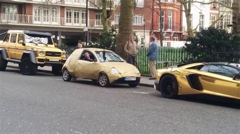 gold g63 fake gold ford ka parking between gold lamborghini aventador and g63 6x6 must see
