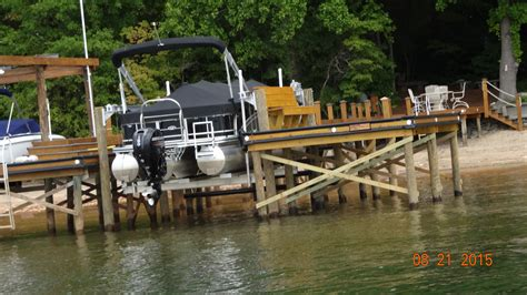 Tritoon Boat Companies by Boat Lifts Us Dock Builder Installing Top Of The Line