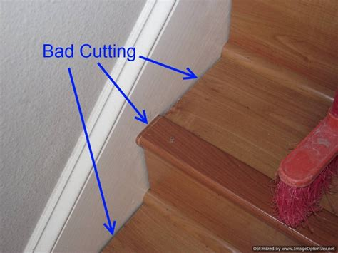 floating wood floor laminate on stairs with bad installation