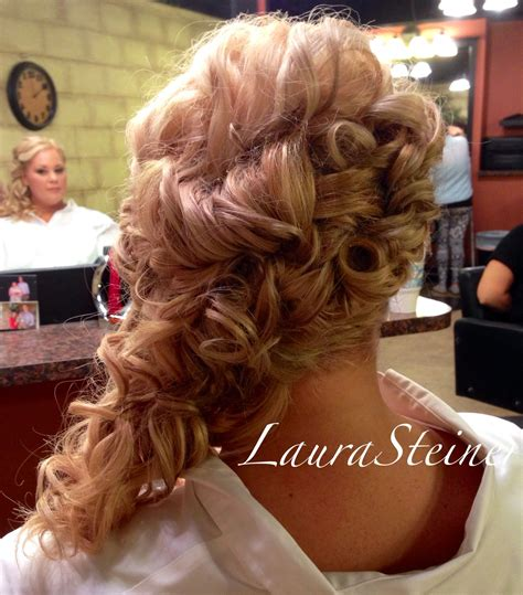 Bridal updo with cascading curls off one shoulder. Lots of