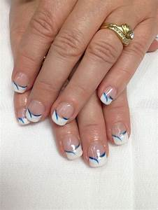 White French gel nails with royal blue accent swishes. Go ...