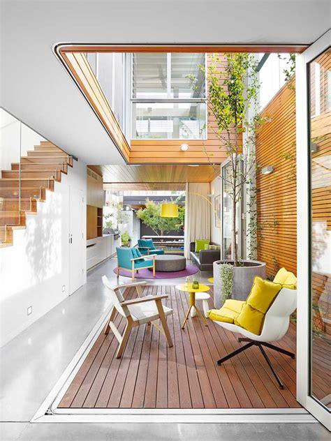 narrow lot family house designed   courtyard
