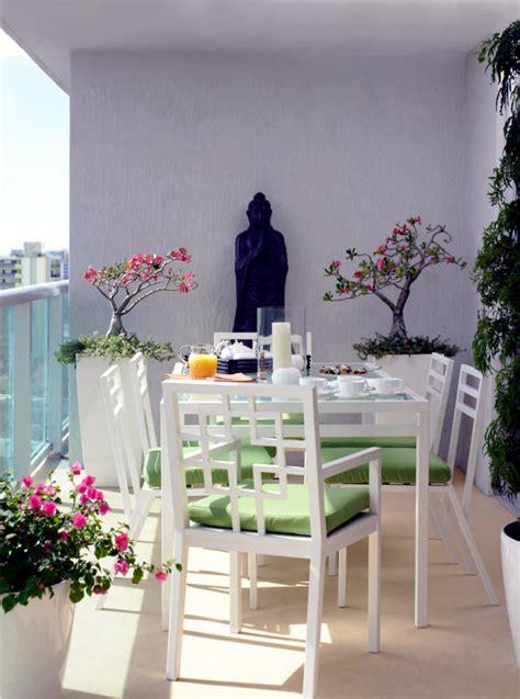 buddha statue   balcony  white furniture